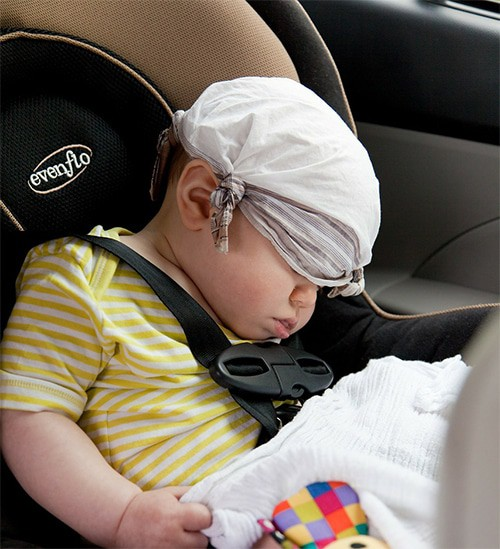 Baby boy is sleeping at evenflo car seat