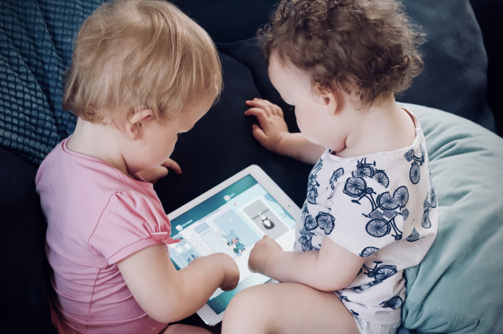 toodlers playing tablet