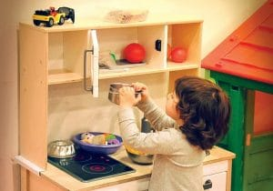 Child Paying her kitchen Toys