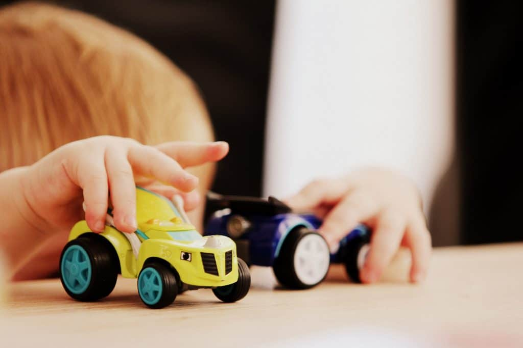 Playing with assorted car toys