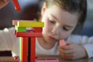 Girl playing colorful blocks