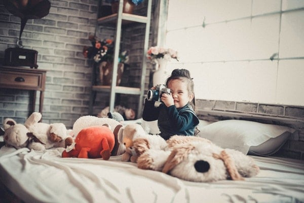Adorable Child Holding Camera