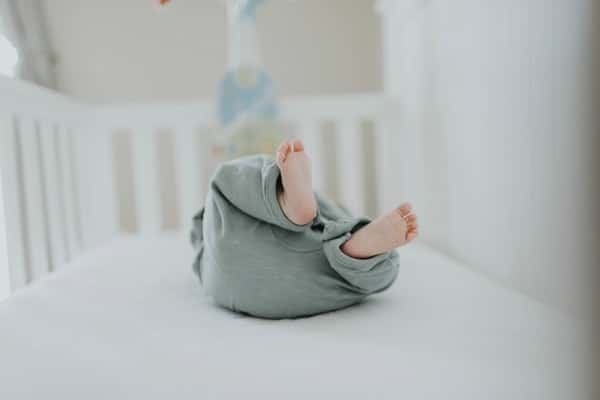 photo of baby wearing gray pants