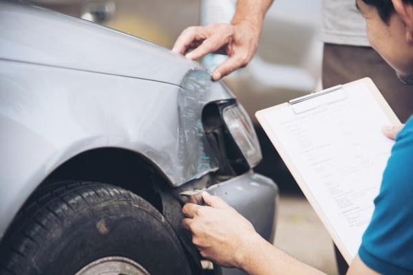 insurance agent working during site car accident claim process