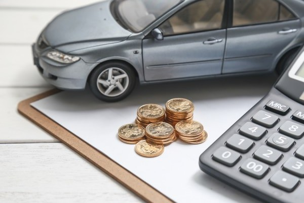 car model calculator coins white table