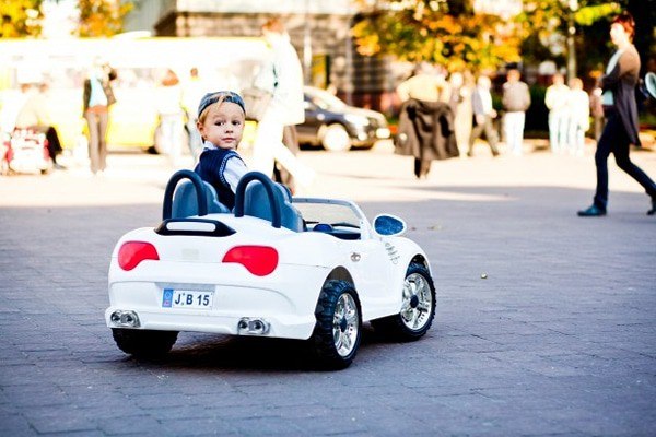 Cute little boy drives his first car