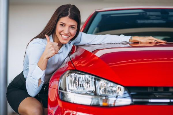 Young woman buying car