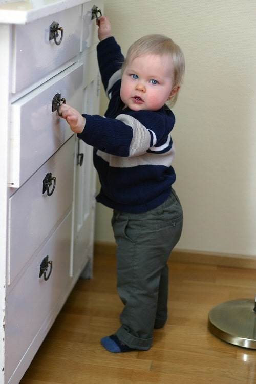 baby attempt to open the drawer