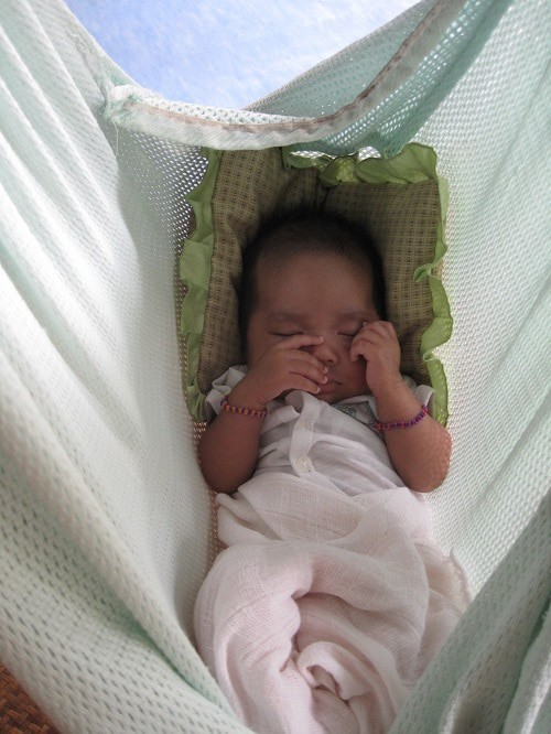baby sleep in green hammock