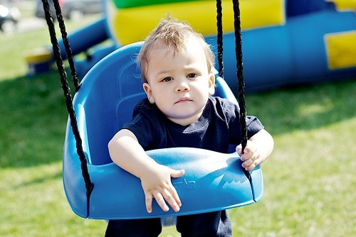 baby in blue swing