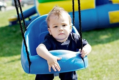 baby in blue swing