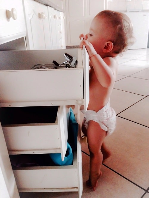 baby opened the cabinet