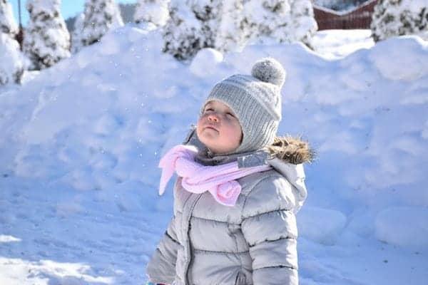 Child in snow wearing coat