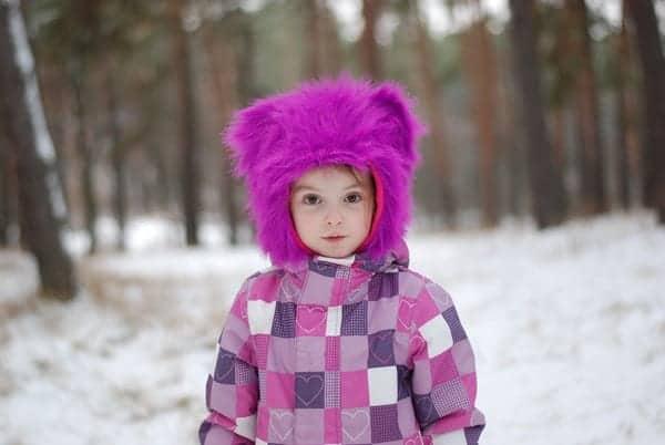 Child in Pink snowsuit