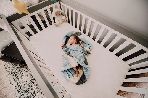 Baby inside the white crib