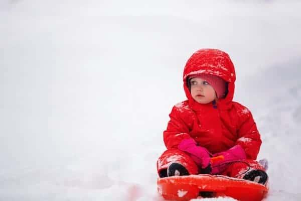 Child in red snowsuit