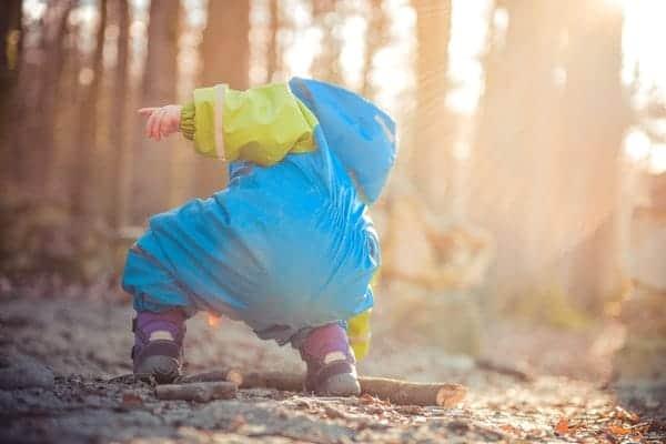Child wearing Blue-Green raincoat