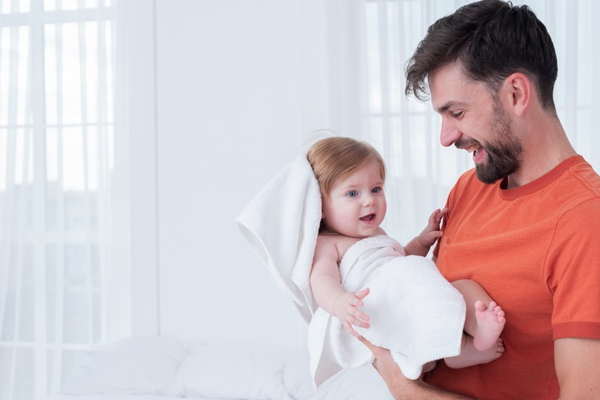 Father Holding Baby in Towel