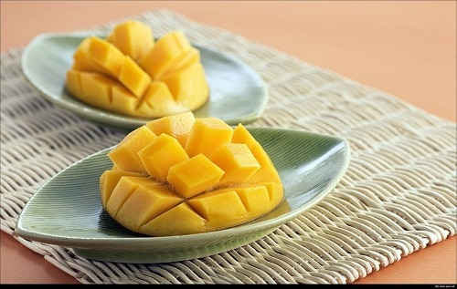 two sliced mango