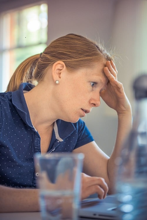 stress woman wearing blue shirt