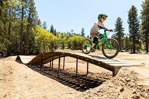 boy playing green bike
