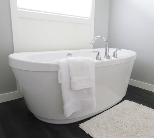 bathtub with white towel