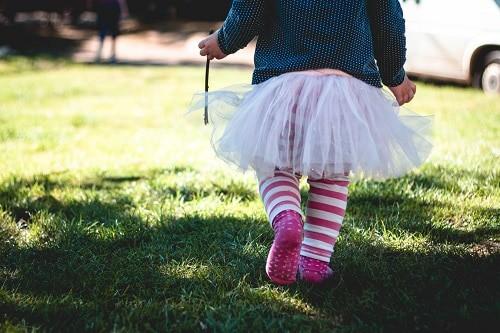 walking baby wearing tutu