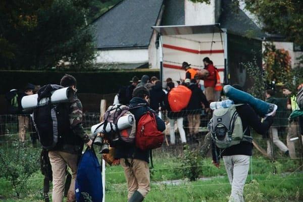 People bringing backpack