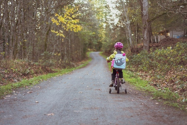 Toodler Riding Bicycle with backpack