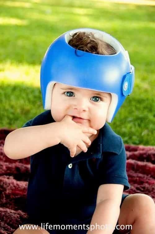 baby wearing safety helmet