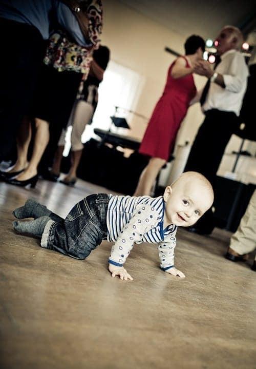baby crawling while smiling