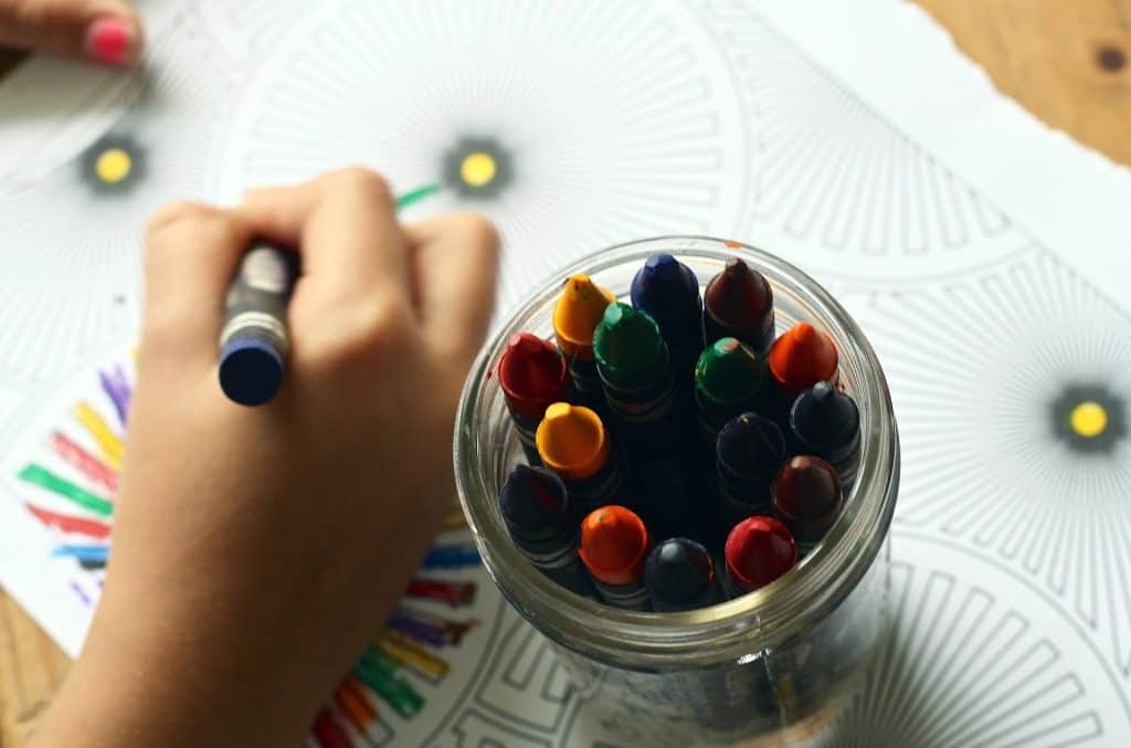 A child colors to ease cabin fever