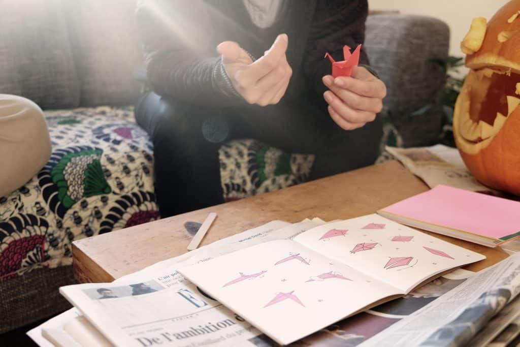 Teenagers with cabin fever learn origami