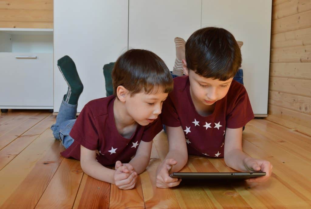 Two boys using a LeapFrog Epic Academy Edition app on a tablet